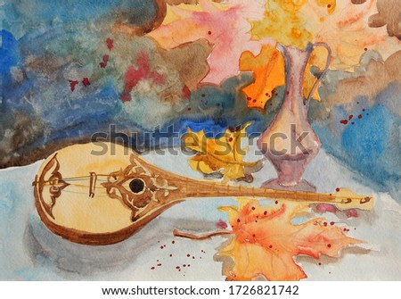 oriental musical instrument lies on the table among the autumn maple leaves. watercolor painting