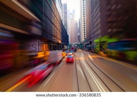 Watercolor painting effect. Moving through modern city street with skyscrapers. Hong Kong. Abstract cityscape traffic background with taxi car driving. Motion blur, art toning