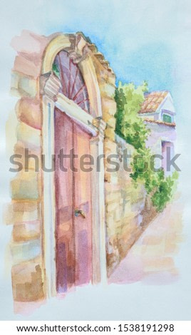 On white paper, by hand, watercolor painted old street of a European city. A high ancient entrance door with stucco molding and a copper handle, a bed of stone masonry walls, stones of the pavement
