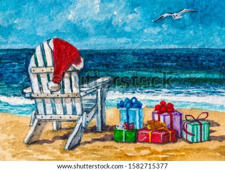 Christmas presents on the beach. White wooden chair lounge with Santa hat and gift boxes at the sea coast.