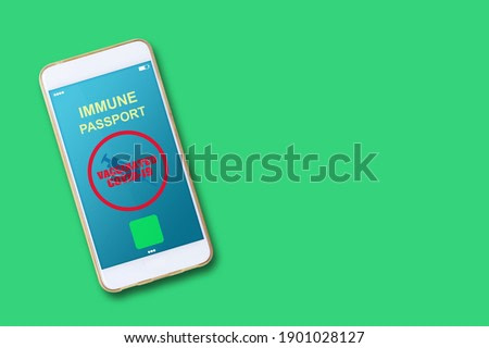 Electronic Immunity passport with a COVID-19 vaccination stamp on a smartphone screen. Copy space. For people vaccinated against COVID-19. Medicine and health.