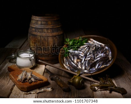 Still life with fresh anchovies and salt