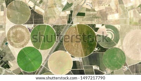 life circles, allegory, tribute to Picasso, abstract photography of the Spain fields from the air, aerial view, representation of human labor camps, abstract, cubism, abstract naturalism,