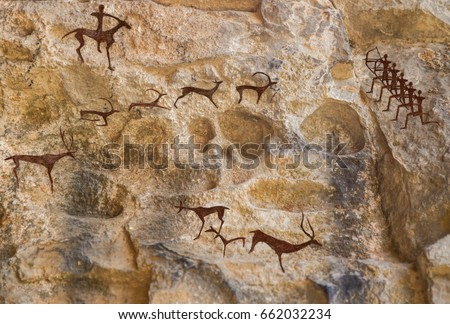 Cave paintings of primitive man. Ocher paint. Hunters hunt deer. Caveman, Neanderthal, drawings in the cave