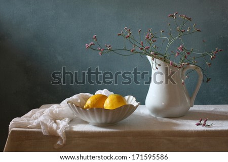 Still life with lemons and spring flowers