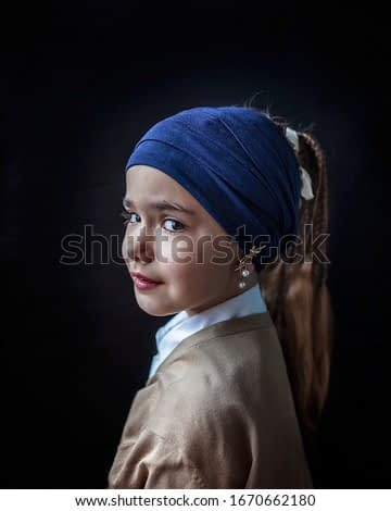 Close-up portrait of cute 7-8 years old girl in blue scarf on the hair and pearl earring, beauty and art, classic light scheme, dark key background