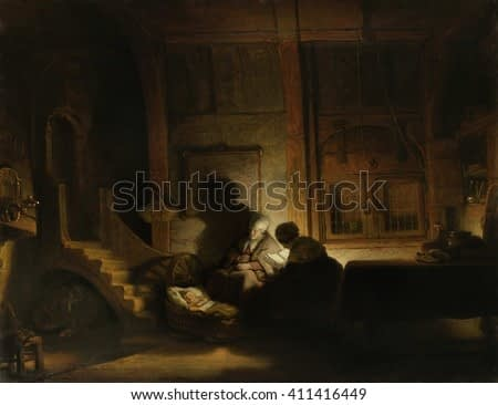 The Holy Family at Night, by workshop of Rembrandt van Rijn, 1642-48, Dutch painting, oil on panel. Interior lit by candlelight, Mary reads from a book. Anna holds the cord to rock the cradle. Joseph
