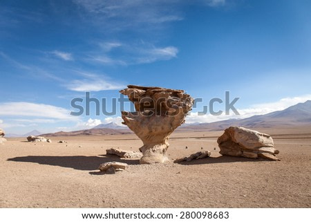 Stone tree, Bolivia ( Árbol de Piedra ). Isolated rock in the desert. Blue sky background
