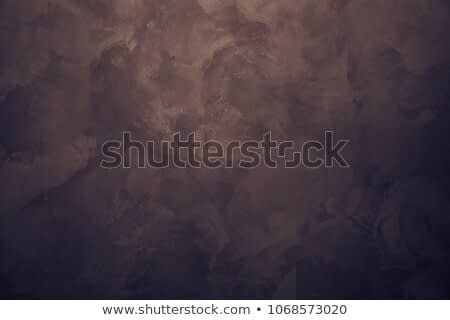 Chocolate brown background. Wall. Rough strokes of the master.