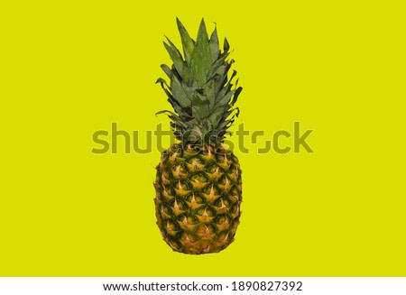 Pineapple on a yellow background, fresh natural pineapple.