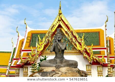 Impressionist sculptures are acting to relieve the aches of the body in Wat Pho, Bangkok, Thailand.