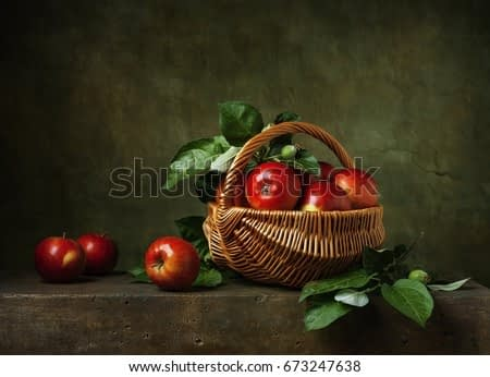 Still life with apples in a basket