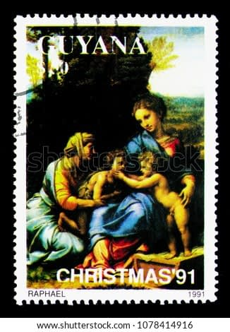 MOSCOW, RUSSIA - MARCH 28, 2018: A stamp printed in Guyana shows Raphael, Christmas serie, circa 1991