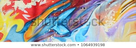 Abstract graffiti paintings on the concrete wall. Background texture