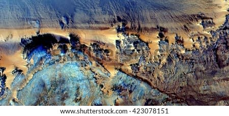 magical cliffs,  abstract photography of the deserts of Africa from the air. aerial view of desert landscapes, Genre: Abstract Naturalism, from the abstract to the figurative, contemporary photo art
