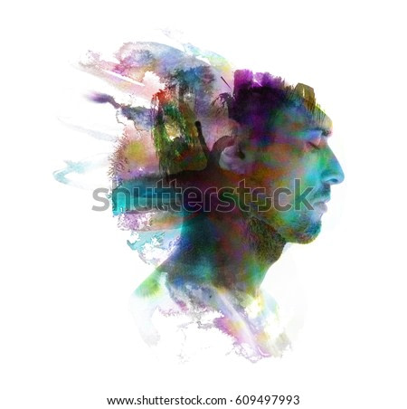 Profile portrait of a sexy man with a colourful painting dissolving behind him
