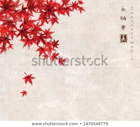 Red leaves of japanese maple in fal on rice paper background in vintage style. Traditional Japanese ink wash painting sumi-e. Hieroglyphs - eternity, freedom, happiness, beauty