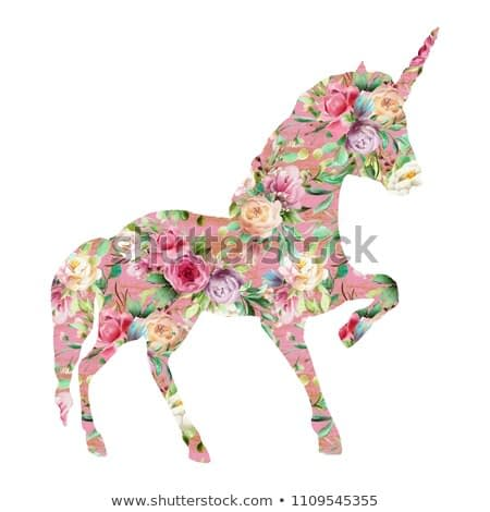 Beautiful unicorn, magic horse, fantasy silhouette, double exposure with watercolor flowers pattern