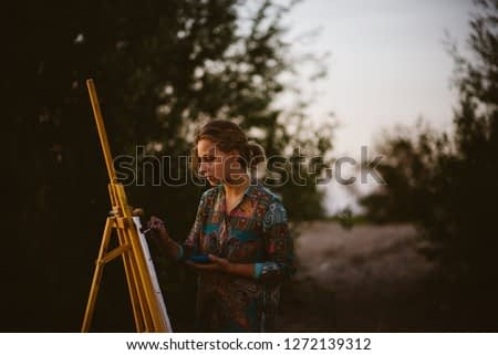 Miro art painting in nature on easel