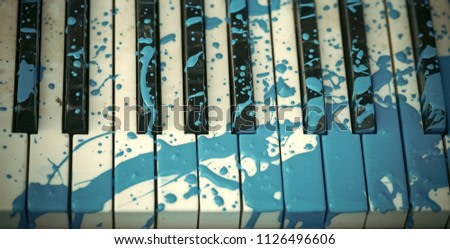 Modern Art. Painted piano, musical style, grunge instrument. Pop and classical music, melody, rhapsody. Art, decoration, design, old piano. Piano in blue paint stain, keyboard Music academy jazz