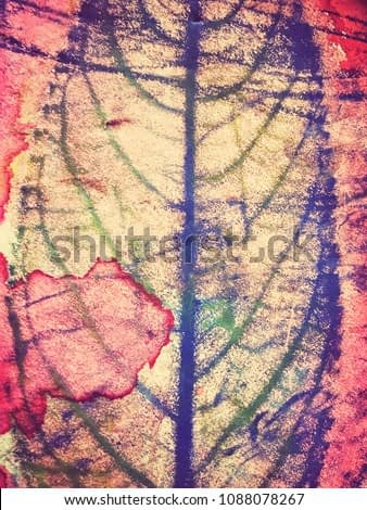 Watercolor painting of leaves in painted background. Paper with full painted watercolor surface.