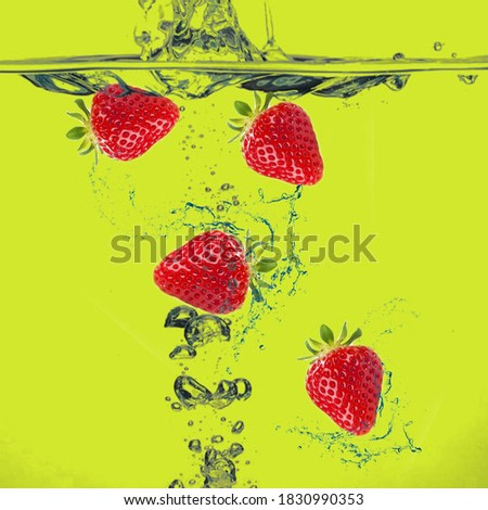 strawberry in the splash water