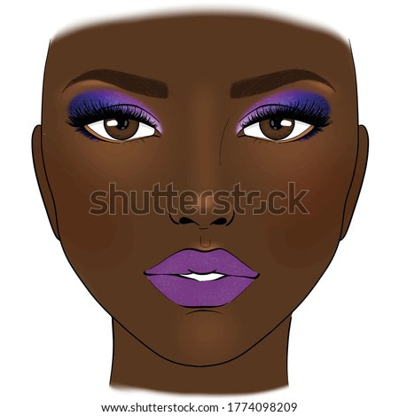 Beautiful woman with purple lipstick blue glitter eye shadow and blush brown skin foundation