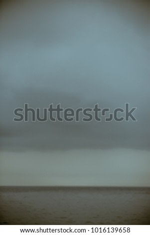 Inspired by Rothko, expresionist blue background of clouds over the see out of focus for a more pictorial sensation