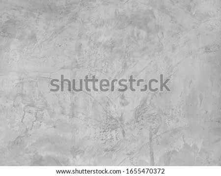 art of concrete surface, cement painting for background in black and gray colors, finishing backdrop on masonry wall.