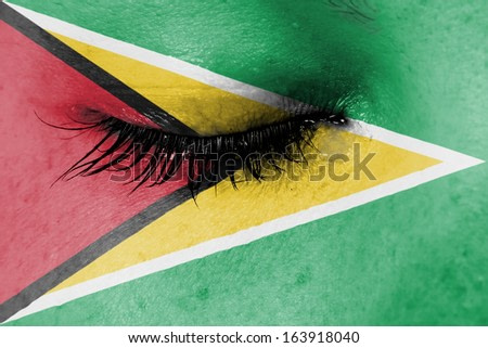 Crying woman, pain and grief concept, flag of Guyana