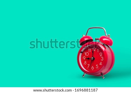 Blue  alarm retro clock on blue background.