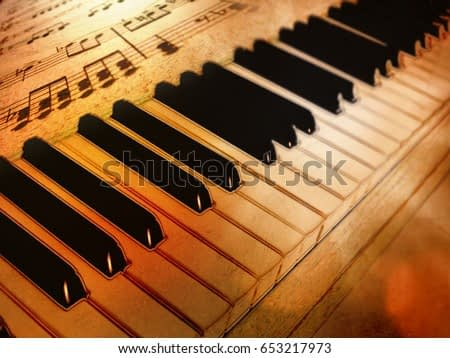 Vintage piano keys and sheet music with drawing effect