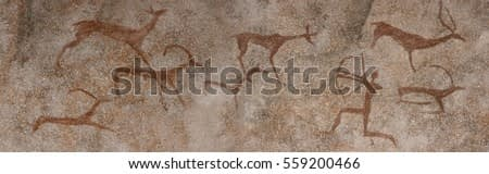 Figure animals and hunter on the stone wall of the cave paint ocher ancient prehistoric Neanderthal. prehistoric animal, stone age hunting for deer. primitive man