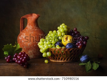 Still life with pears and grapes and plums