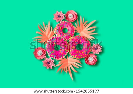 Paper donuts with pink icing and pink leaves. Volumetric handmade paper objects. Summer design. Paper art and craft. Trendy hobby. Minimal art food concept. Copy space