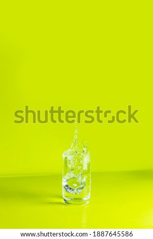 Glass of mojito mint drink with splash. Summer art food concept on green background.