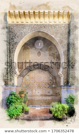 Traditional ornamental detail fountain in medina of Fez, Morocco. Decorated with mosaic tiles. Moroccan traditional islamic art. Watercolor sketch painting. Retro style postcard.