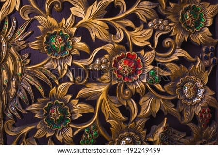 Thailand Art. Pattern of flower carved on wood background.