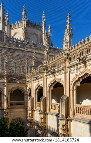 Gothic Cloister - Bright evening sunlight shines on exterior architectural details of upper cloister of 15th-century Isabelline Gothic style church Monastery of San Juan de los Reyes, Toledo, Spain.
