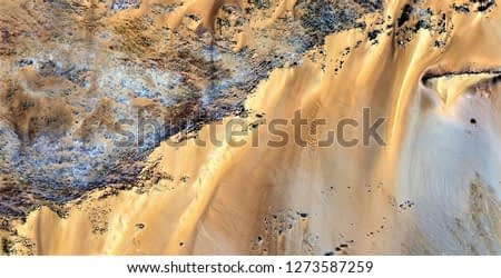 golden cliffs, tribute to Pollock, abstract photography of the deserts of Africa from the air, aerial view, abstract expressionism, contemporary photographic art, abstract naturalism,