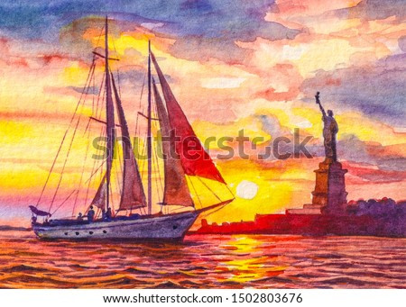 New York city. Statue of Liberty at sunset with a sailboat or big sail yacht.