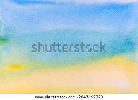 Watercolor drawing on paper. Watercolor. Smooth yellow-blue transitions through water spots. Abstract blurred image of the coastline of the beach. Water and sand