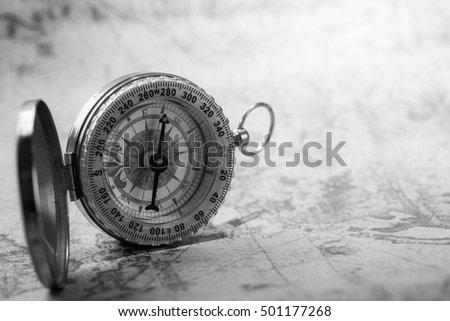 VIntage compass on old map. Black and white photo