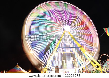 Long exposure of a colorful ferris wheel at night