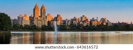 Panoramic view of Central Park West high-rise buildings and the Jacqueline Kennedy Onassis Reservoir at dawn. Upper West Side, Manhattan, New York City