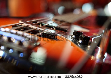 bass guitar photographed on stage in bright spotlights