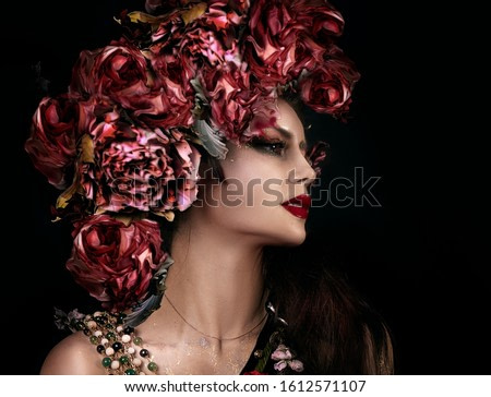 close up portrait of young beautiful girl with flower professional makeup. flower crown on head.  bright face art. spring fairy of flowers. Profile
