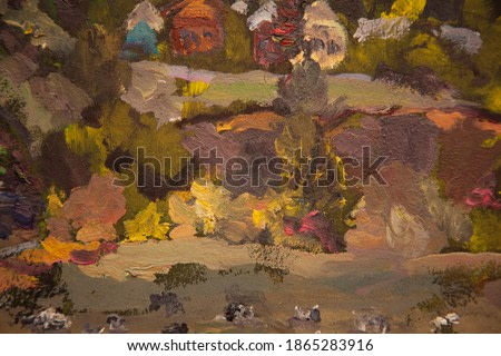 Picturesque landscape overlooking the village,cows graze in a field surrounded by ravines.Oil painting.