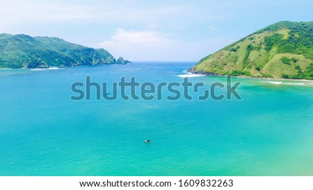Aerial drone, bird's eye view photo from north of Mawun beach, Lombok Island, Indonesia. Green hills and blue sky. View of another side of mandalika circuit in Lombok. Background of beach Lombok.