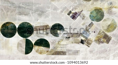 The power of the wind, farms of human crops in the desert, abstract photography of the deserts of Africa from the air, Genre: Abstract Naturalism, from the abstract to the figurative,